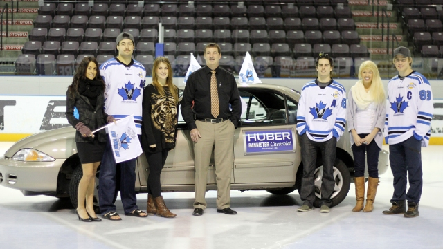 Vees Captains (L to R) Chris Rygus, Travis Blanleil and Brad McClure along with Ken Huber of Huber Bannister Chevrolet and staff from Earl's Restaurant, pose in front of a 2000 Chevrolet Cavalier. The car will be raffled off this Wednesday
