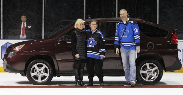 Vees fan Linda Lawrence posing in front of her new car