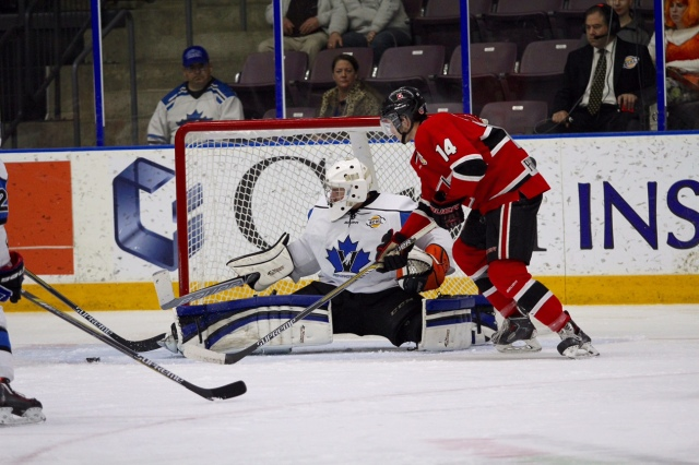Zach Driscoll making on of his 27-saves Friday night